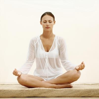 Woman breathing in Yoga position