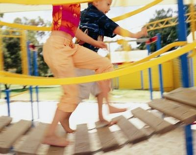 Climbing, running, jumping and navigating play equipment are all ways in which play can enhance the development of large muscles.