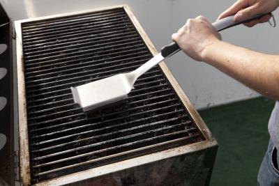 Cleaning grill.