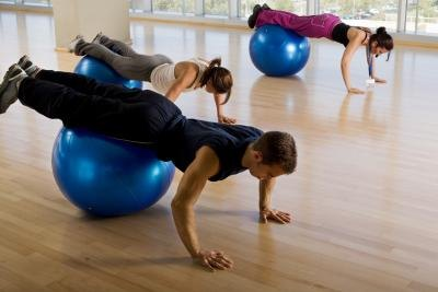 Core exercises with a stability ball help you improve balance. .