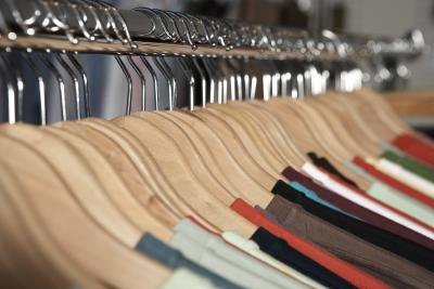 Clothes hanging on a rack.