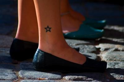 uncovred tattoo on ankle