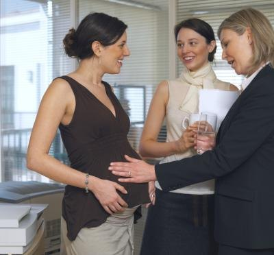Pregnant woman at the office