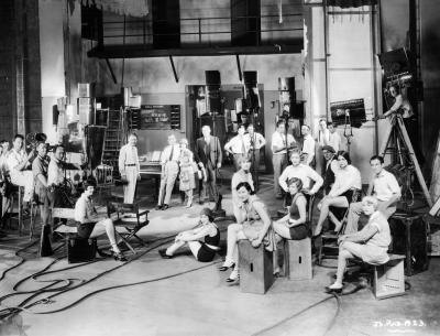 "Actors and actresses on set during filming of ""The Jazz Singer"""