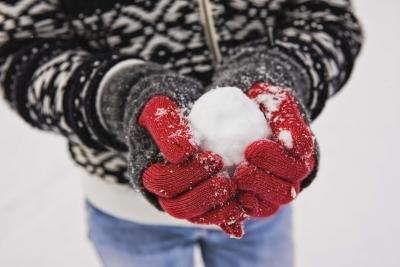 Man holding snow ball in hands