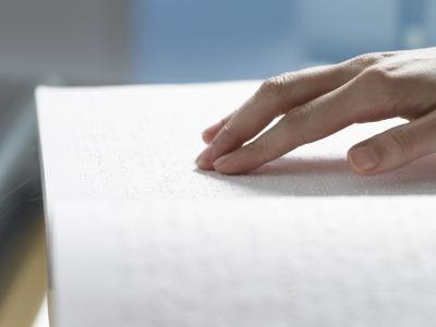 Woman reading braille