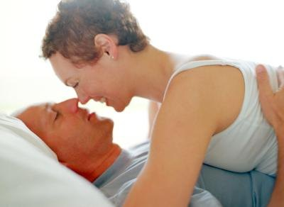 Mature couple embrace in bed