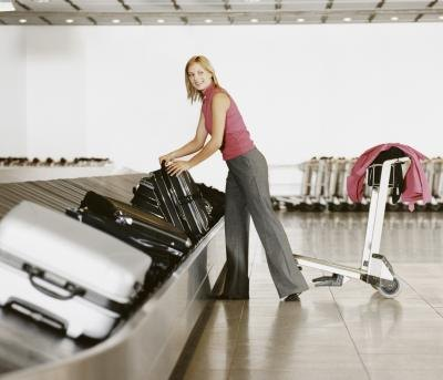 Checking a passenger's bag may also be a requirement of a transportation agent.