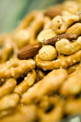 Nuts and pretzels may leave remnants in your mouth long after you eat.