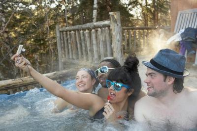 Friends taking photos in hot tub