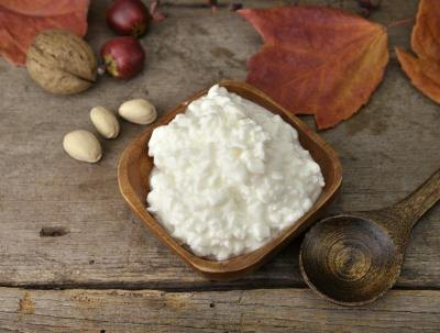 Cottage cheese in wood bowl