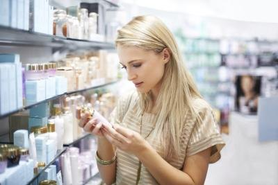 Woman reading a product label at the drugstore