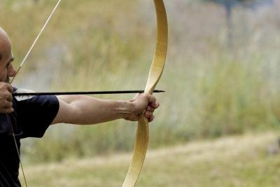 Man shooting arrow from bow