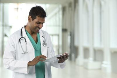 Doctor looks at patient information on tablet