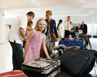 Young girl traveling with adults at airport security.