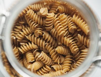 Bowl of uncooked whole wheat pasta