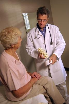 Elderly woman talking to doctor