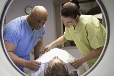 MRI technicians preparing patient