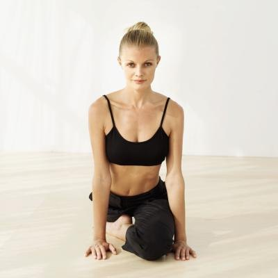 A woman holds pigeon pose.