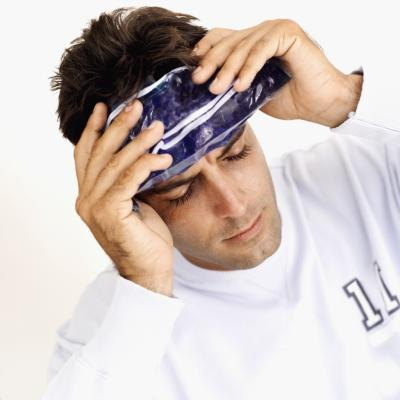 Man with icepack on forehead