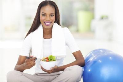Young woman eating a healthy meal after a workout
