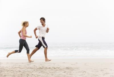 Couple jog on beach