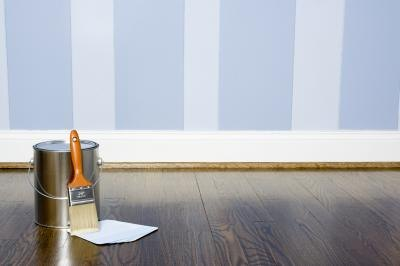 Paint the marked space with the same color as the walls but in a high-gloss paint