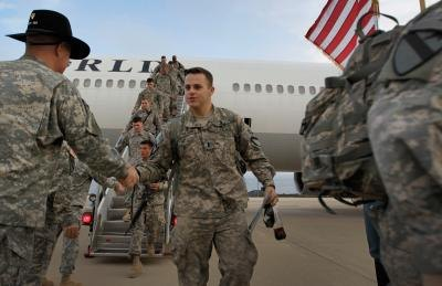 U.S. Army lieutenant being greeted upon return to home base at Fort Hood, TX.