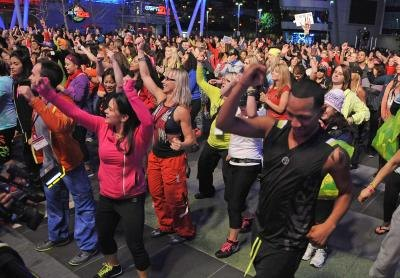 Arena filled with Zumba fitness class