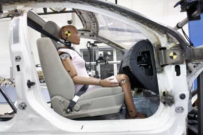 Crash test dummy in car frame