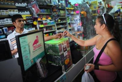 Woman buying lottery ticket in Hollywood, Florida