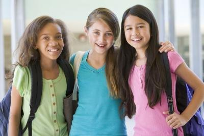 A group of preteen girls at school.