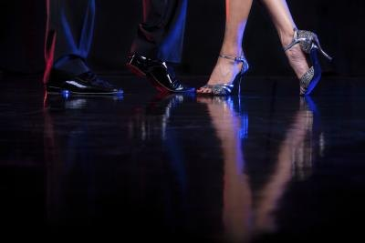 Professional Latin dancers; view of their dancing feet.