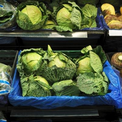 Fresh cabbage for sale at a market.