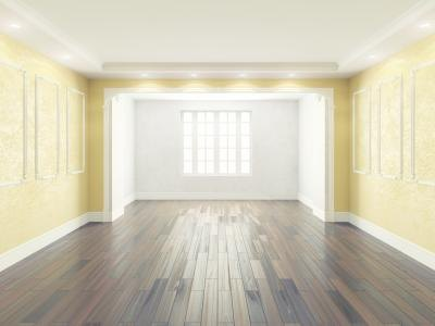 Yellow walls work well with oak cabinetry and dark wood flooring