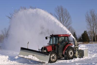 Small vehicle plowing snow