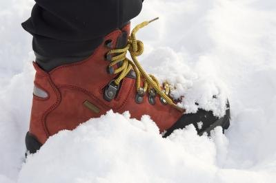 A snow boot with laces.