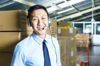 Customer service agent working in shipping warehouse
