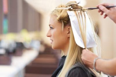 woman getting highlights in salon