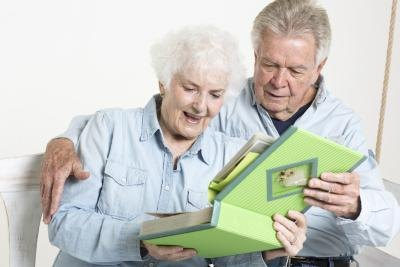 Seniors looking through scrapbook together
