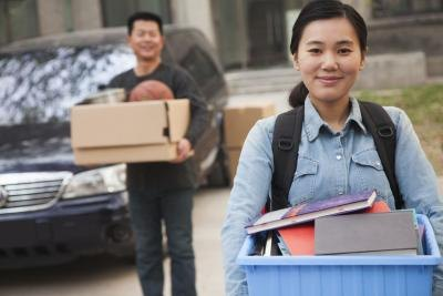 young college student moving into dorm