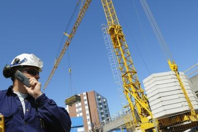 Public works director talking on a cell phone at a construction site
