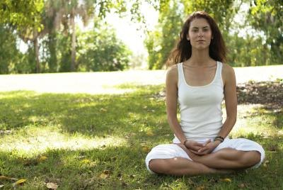 Sit and breathe with your hands resting on your stomach which will encourage breathing to go lower into the lungs