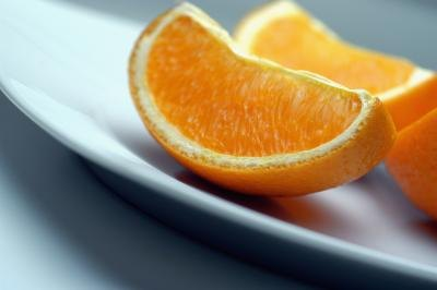 Orange wedges on a plate.