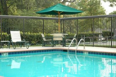 Fences around swimming pools provide safety and decrease liability to the property owner.