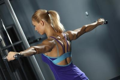 A woman is exercising her shoulders.