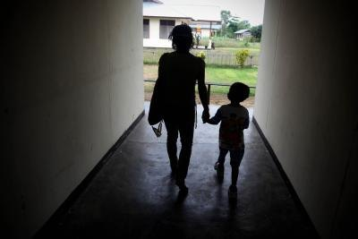 Mother with child in hallway