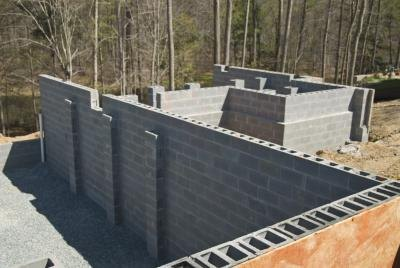 Add a wall of masonry or a solid fence to your backyard.