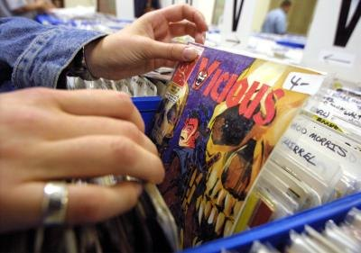 Collector browses through bins of comic books