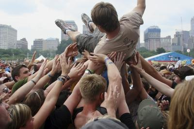 Crowd surfer at concert